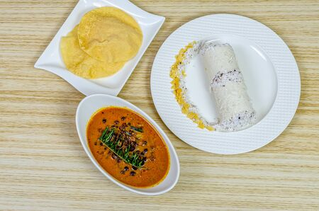 Traditional Kerala breakfast dish - Puttu with black chickpeas curry & pappad