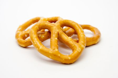 Pretzels small pile of salted pretzels isolated on white