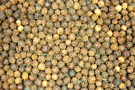 Backround of whole peppercorns