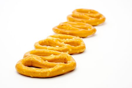 Isolated row of pretzels with focus emphasis