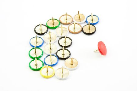 Brightly coloured drawing pins with concept of leadership