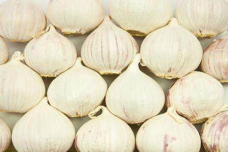 Garlic bulbs background on flat plane Stock Photo