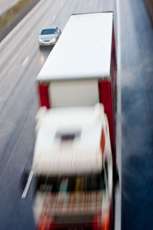 High view of truck and car blurred at speed photo