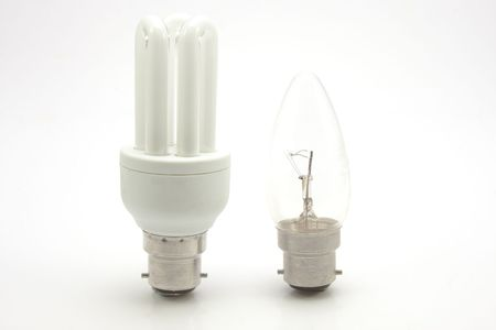 Environmentally friendly and normal incandescent light bulbs isolated on white Stock Photo