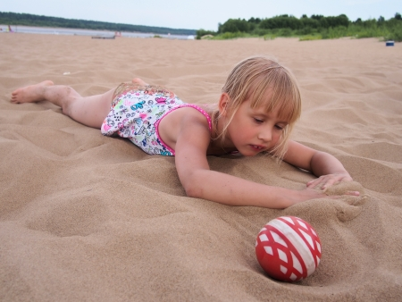 Girl lies on sand at the beach Stock Photo - 21201190