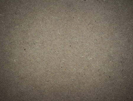 abstract brown background or brown paper with warm center photo