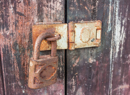 keylock: Old key lock on wooden wall