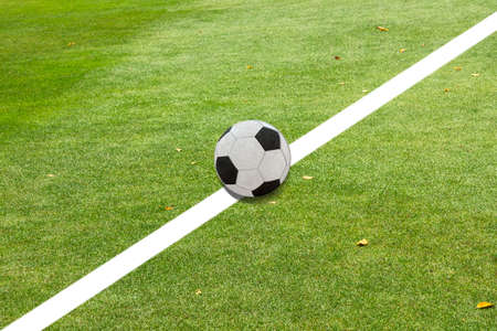 synthetic: White line on soccer field grass Stock Photo