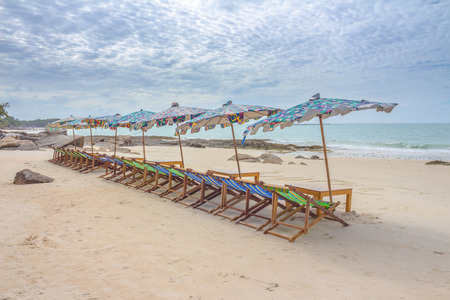 longue: Beach and chair on sand beach. Concept for rest, relaxation, holidays, spa, resort. Stock Photo