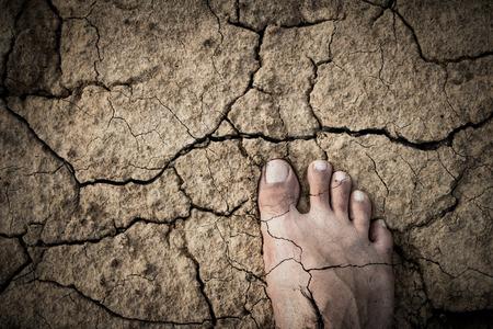 feet naked: Naked Feet on dry Soil Stock Photo