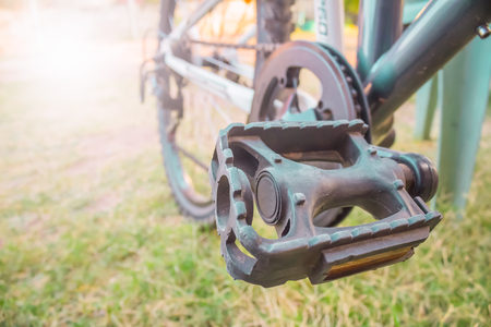 Low viewing angle leg on mountain bike pedal photo