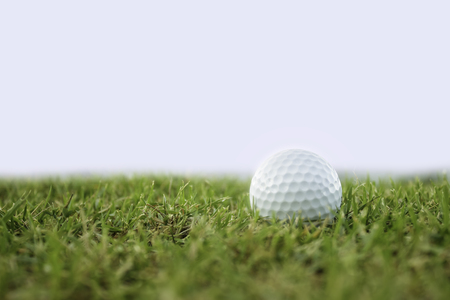golfball: golf-ball on course isolate Stock Photo