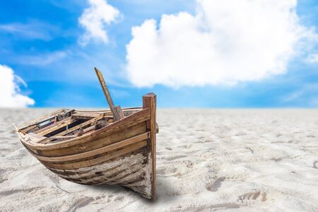 Old fishing boat stranded on a beach in sunny day Stock Photo