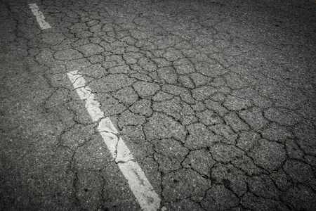 rough road: Dark asphalt road with cracks. Background texture Stock Photo
