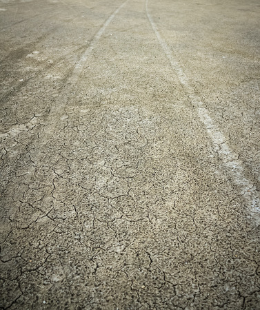 diverging: diverging pattern of four wheel drive tracks in wet yellow sand Stock Photo