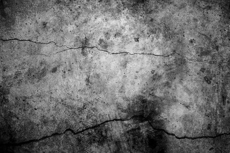 earthquake: black and white cement cracked background Stock Photo