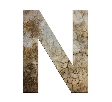 cracked cement: n letter cracked cement texture isolate Stock Photo