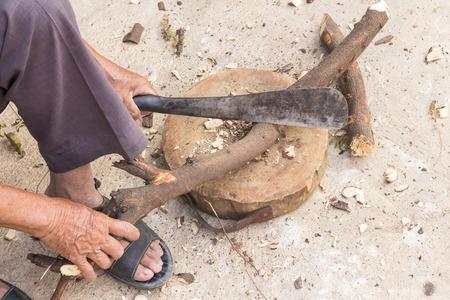 logger: Logger man cutting wood Stock Photo