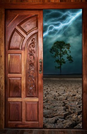desert storm: Wooden door in a desert lightning storm. Stock Photo