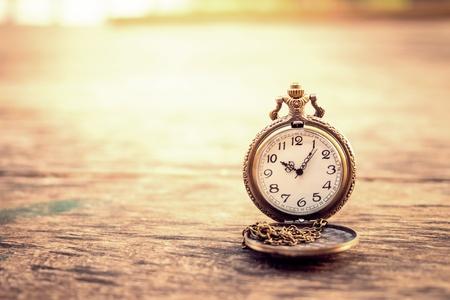 10 12 years: vintage pocket watch on grunge wood log