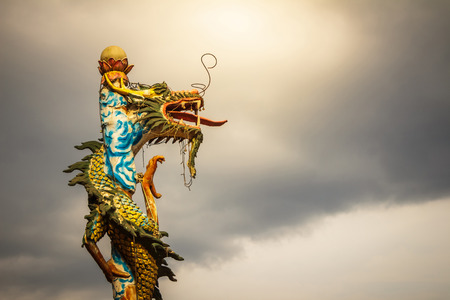 The old dragon statue on pillar