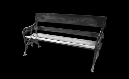 arredamento classico: Vecchia sedia di legno su sfondo nero Archivio Fotografico