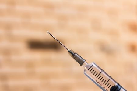 Syringe with needle on blur background Stock Photo