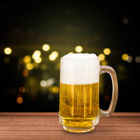 unbottled: Glass of beer on bokeh background