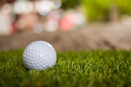 Golf ball on green grass for golfing Stock Photo