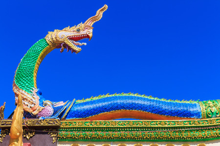 Traditional Thai style art of naga on the roof in temple, Thailand Stock Photo
