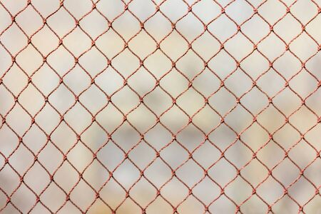 wire netting as background over earth