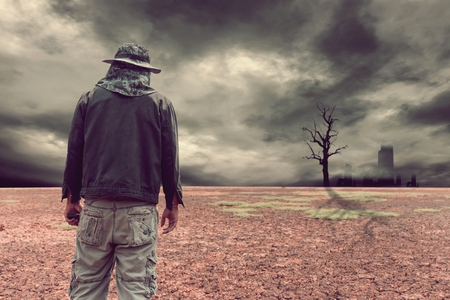 Abstract Man on land to the ground dry cracked. Stock Photo