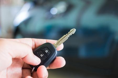 open autocar auto: Hand presses on the remote control car alarm. Stock Photo