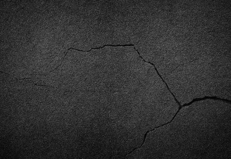 Crack background texture of rough asphalt