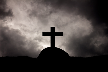 Rain clouds on Christian crosses graves. Stock Photo