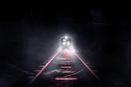 Old trains run through old tunnels at night. Stock Photo