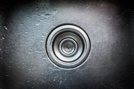 Bathroom wash basin drain outlet