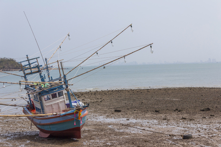 Old fishing boat parked on the beach. Stock Photo