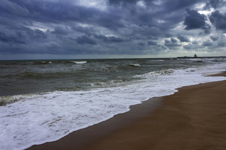 Rainy beach is falling with sunlight Stock Photo