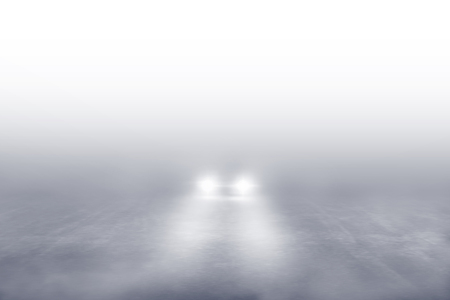 Car driving the Fog Road