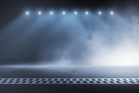 Línea de meta de la pista de carreras en la noche Foto de archivo