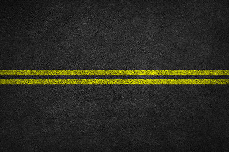 Structure of granular asphalt. Asphalt texture with two yellow line road marking. Abstract road background. Stock fotó