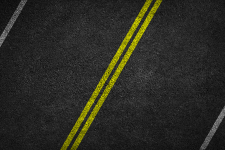 Structure of granular asphalt. Asphalt texture with two yellow line road marking. Abstract road background. Stok Fotoğraf