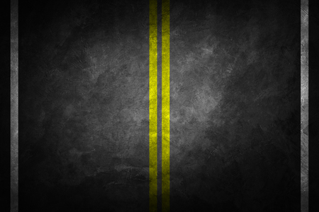 Structure of granular asphalt. Asphalt texture with two yellow line road marking. Abstract road background. Reklamní fotografie