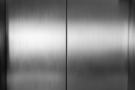 Metal de la puerta del ascensor, fondo de textura de acero inoxidable Foto de archivo