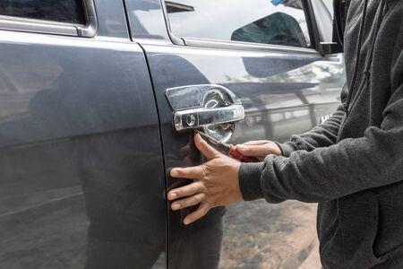 Man burglar stealing car security