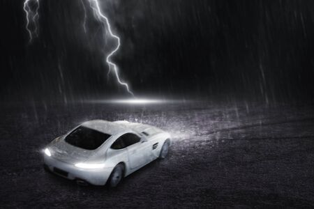 The white sports car that focuses on the back, runs on a road with rain and lightning at night, motion blur concept. 3D Render. Фото со стока
