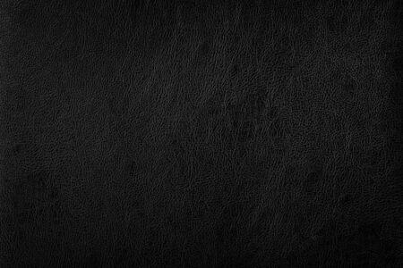 Dunkles schwarzes Ledersofa Oberflächenbeschaffenheitshintergrund