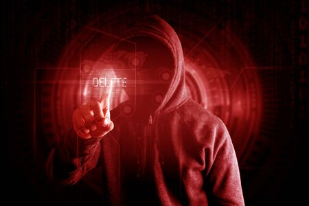 Hackers touch delete button to delete data Virus attack concept, red tone. Stock fotó