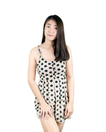 Studio portrait of beautiful caucasian girl in polka-dot dress. Stock fotó